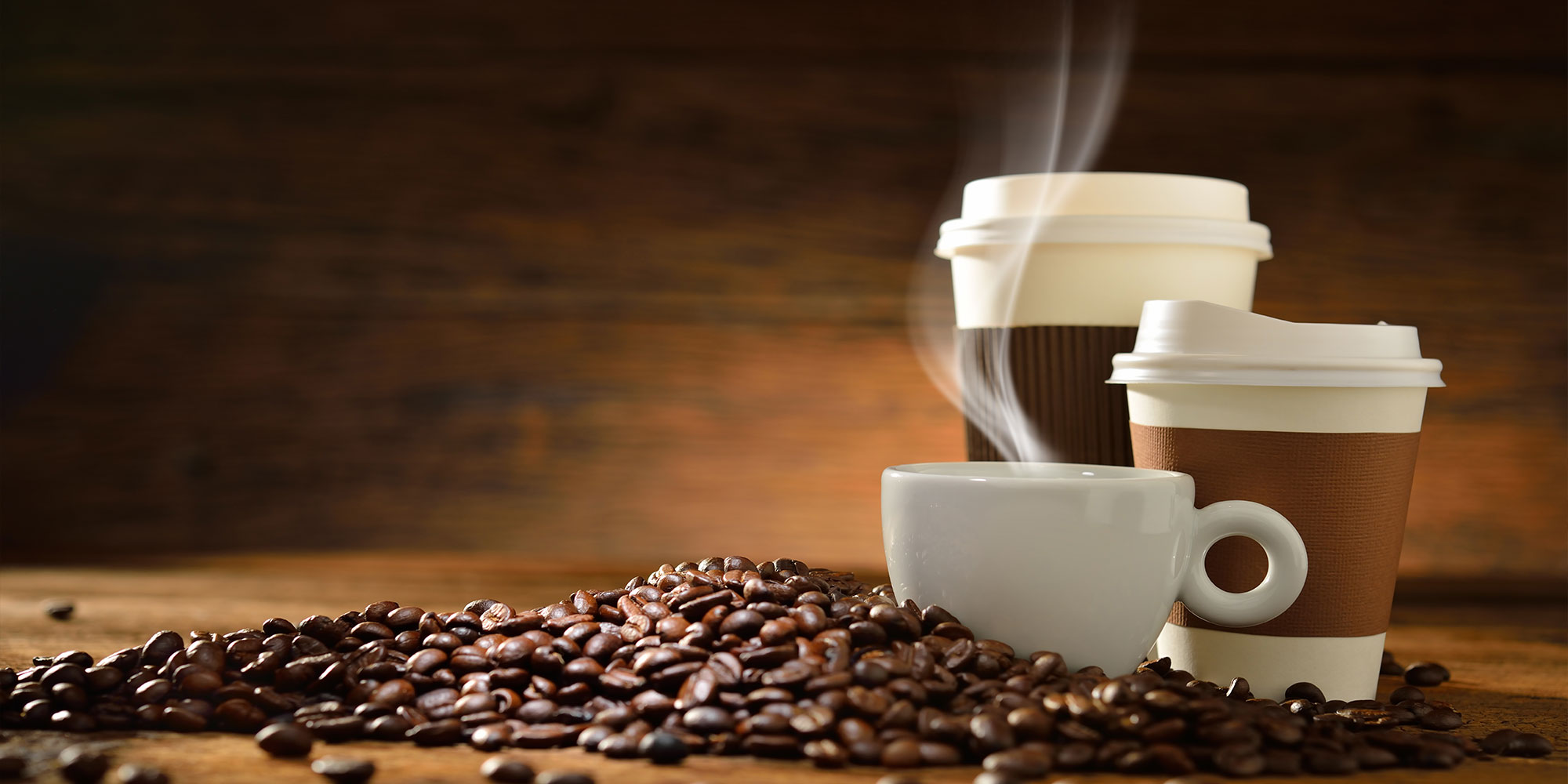 Hot cup of fresh coffee with coffee beans